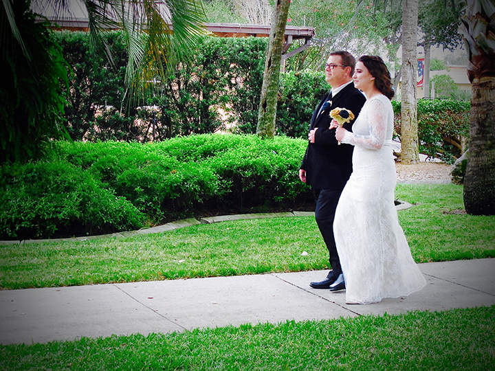 The bride walking down the aisle at her ceremony at the Porcher House in Cocoa, FL.
