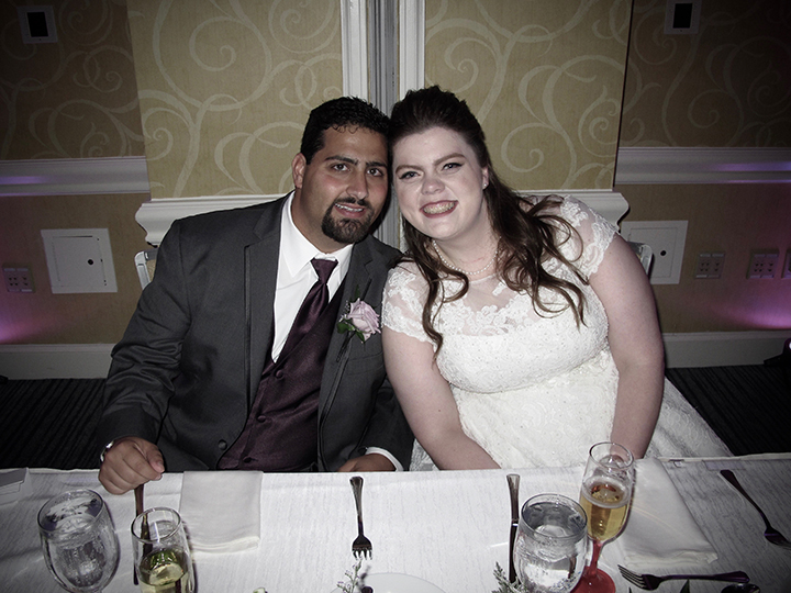 The wedding couple at the their sweetheart table at their Omni Championsgate Wedding.