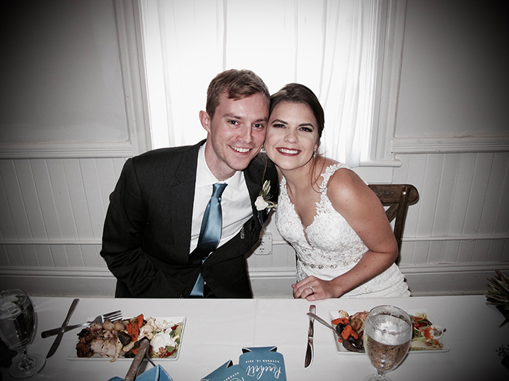 The wedding couple at their sweetheart table at Venue 1902 Preservation Hall in Sanford.