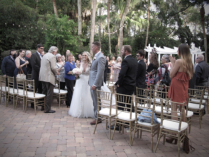 The bride and groom finish their ceremony at the Florida Federation of Garden Clubs.