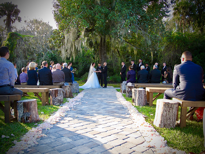 The setting for the ceremony at this Mulberry at New Smyrna Beach Wedding is under the oak tree.