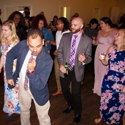 Guests are having fun on the dance floor at this Winter Park Mead Gardens Wedding.