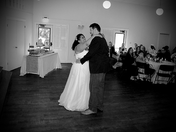 The bride and groom share their First Dance at this Winter Park Mead Gardens Wedding.